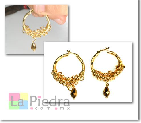 fotos oficiales 053f1 16dce arracadas de chapa de oro con cadena en espiral