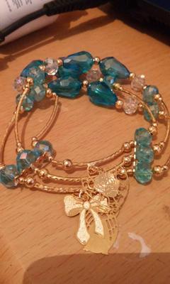 hilo chapa de oro y cristales